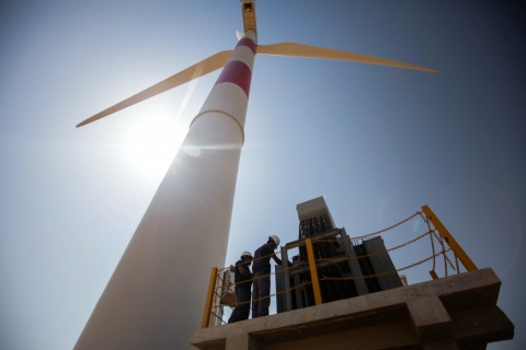 Engineers doing routine maintenance work at a wind turbine in Jhimpir. © Photo by Khaula Jamil/IFC